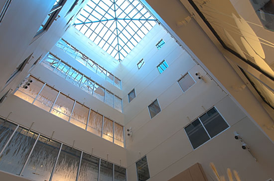 In the center of the building, a lightwell soars from the third to seventh floors, bringing ample natural light into the building's core. There's also a warm, comfortable seating area for general use.