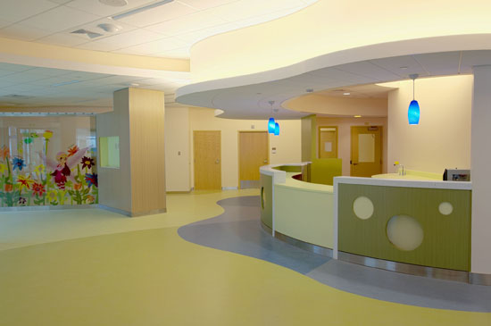 Equipped with adult and child sized equipment, the Sadowsky Family Pediatric Emergency Department is a remarkable unit featuring vivid colors, organic shapes, and animated characters collectively known as the Wellies.